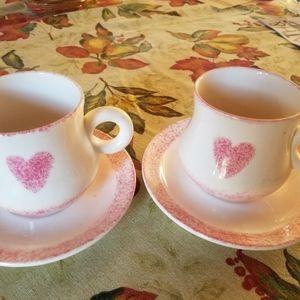 A pair of tea cup sets